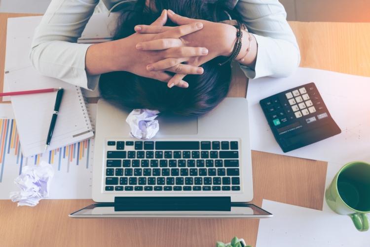 Overworking woman laptop Shutterstock Strong Fit Well