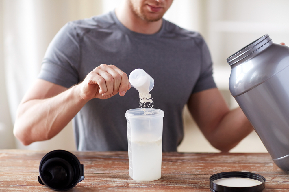 Protein shake powder man Shutterstock Strong Fit Well