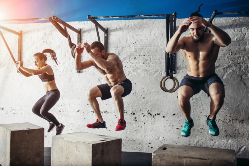 Box jumps group men women Shutterstock Strong Fit Well