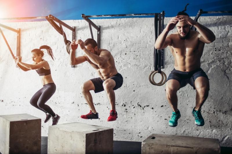 Box jumps group men women Shutterstock Strong Fit Well