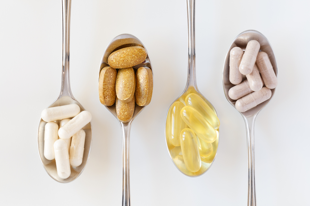 vitamins supplements teaspoons shutterstock strong fit well