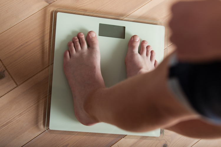 weighing scales Shutterstock Strong Fit Well.jpg