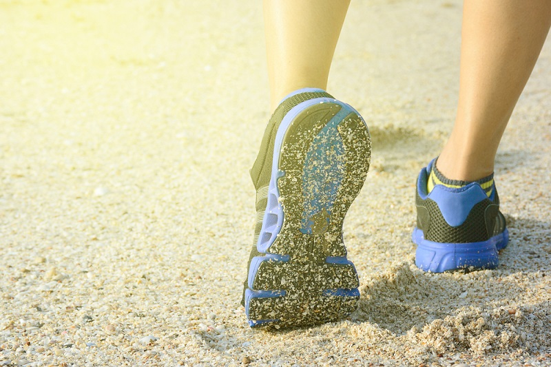 Running shoes on sand beach Shutterstock Strong Fit Well