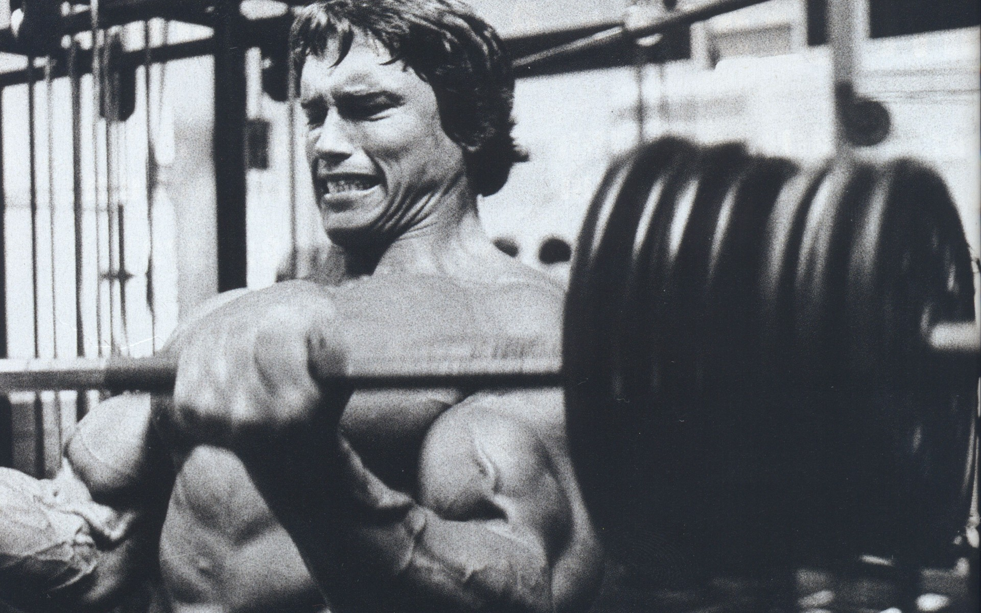 Arnold Schwarzenegger making muscles in 1977 docudrama Pumping Iron