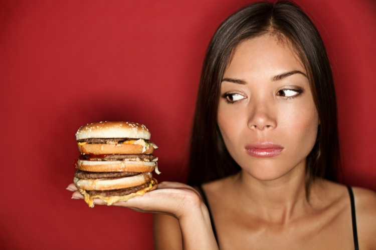 woman looking at burger junk food Shutterstock Strong Fit Well